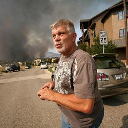 Doug Jepperson is evacuated from his home at the Lodge at Stillwater near the Jordanelle Reservoir on Saturday, Aug. 18, 2012.