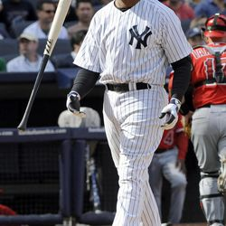 New York Yankees' Andruw Jones flips his bat after striking out to end the eighth inning of a baseball game against the Los Angeles Angels Saturday, April 14, 2012, at Yankee Stadium in New York. The Angels won 7-1.