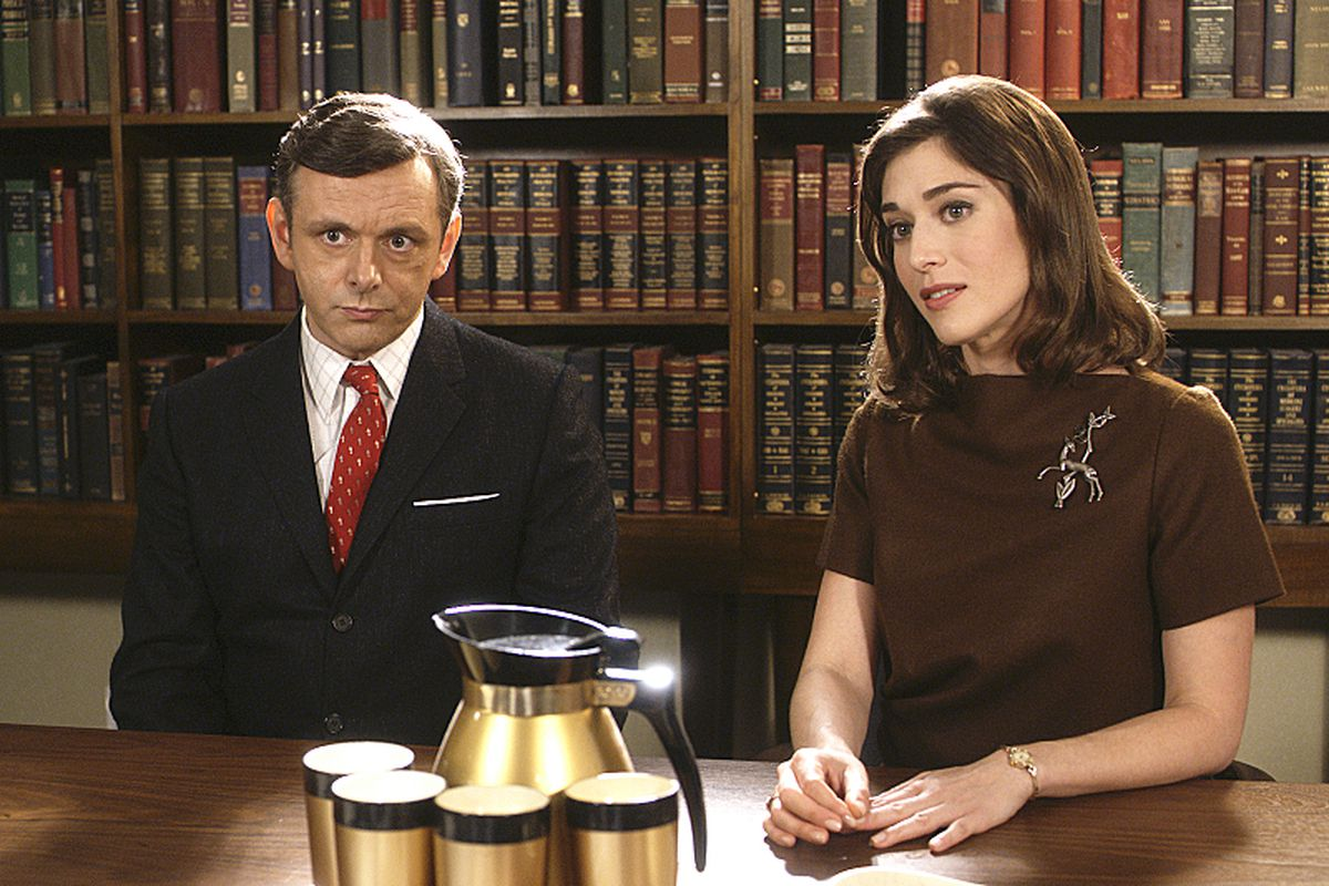 Bill (Michael Sheen) and Virginia (Lizzy Caplan) appear in your homes, thanks to the magic of television.