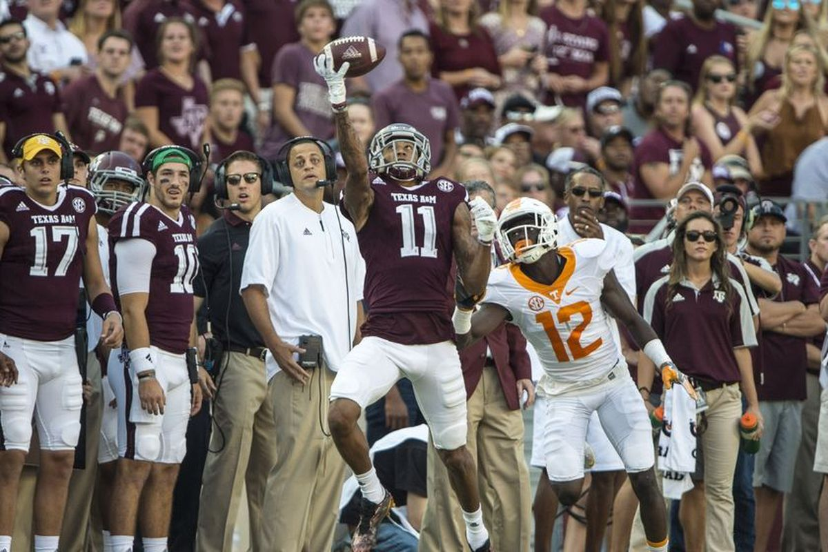 Oct 8, 2016; College Station, TX, USA; Texas A&M Aggies wide receiver Josh Reynolds (11) makes a one handed catch as Tennessee Volunteers defensive back Emmanuel Moseley (12) defends during the second half at Kyle Field. The Aggies defeated the Volunt