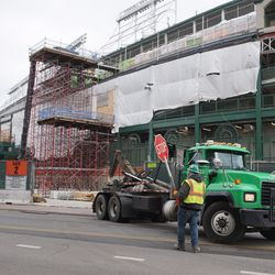 Equipment backing into the construction site, on Clark Street