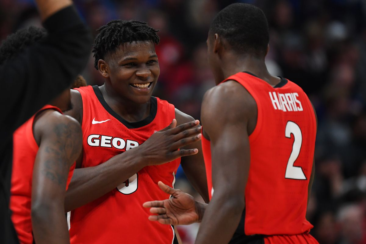 Georgia Bulldogs guard Anthony Edwards and Georgia Bulldogs guard Jordan Harris celebrate after a basket during the second half against the Mississippi Rebels at Bridgestone Arena.