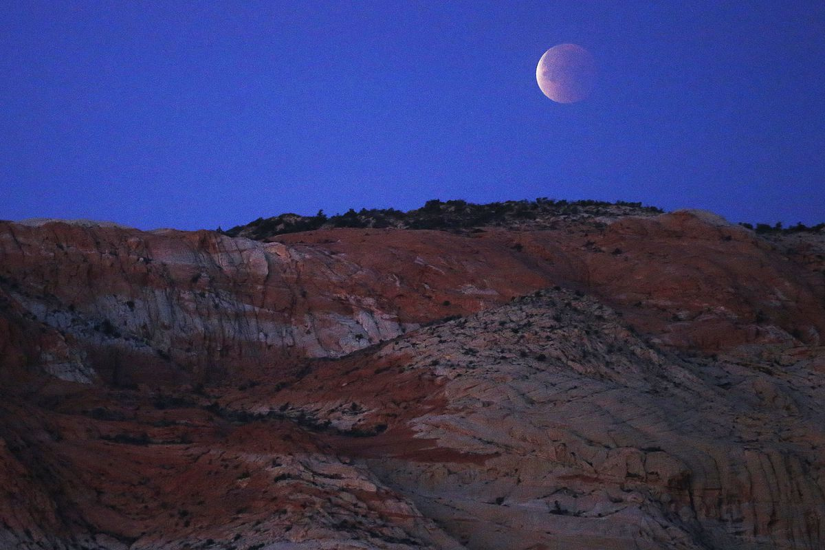 """The """"super blue blood moon"""" in eclipse as seen from above Snow Canyon State Park in Washington County on Wednesday, Jan. 31, 2018."""