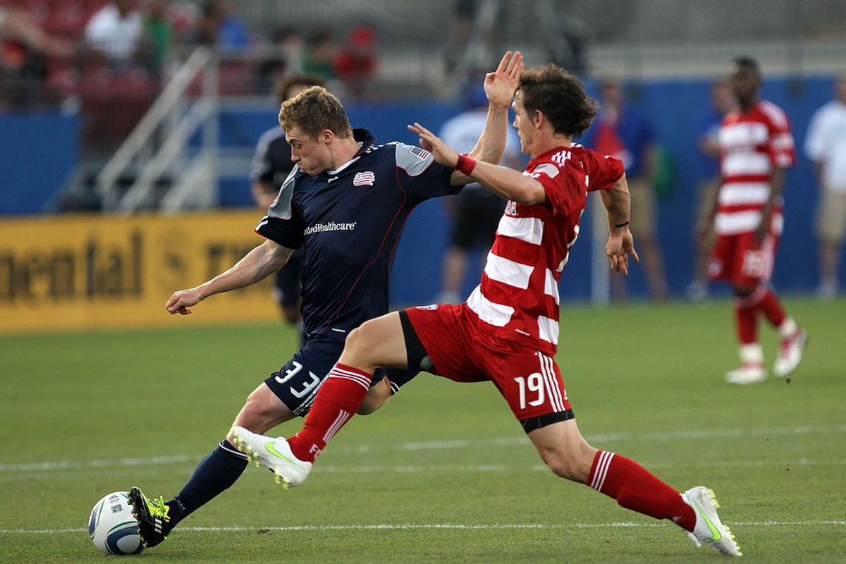 FRISCO, TX - JUNE 04:  Zak Boggs #33 of the New England Revolution dribbles the ball against Zach Loyd #19 of the FC Dallas at Pizza Hut Park on June 4, 2011 in Frisco, Texas.  (Photo by Ronald Martinez/Getty Images)