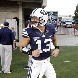 Brigham Young Cougars quarterback Riley Nelson (13) runs on to the field prior to the Utah game in Salt Lake City  Saturday, Sept. 15, 2012.