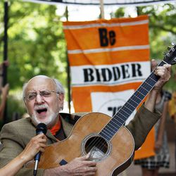 Peter Yarrow, of Peter, Paul and Mary, sings and plays guitar as Tim DeChristopher supporters meet across the street from the federal courthouse in Salt Lake City, Tuesday, July 26, 2011.