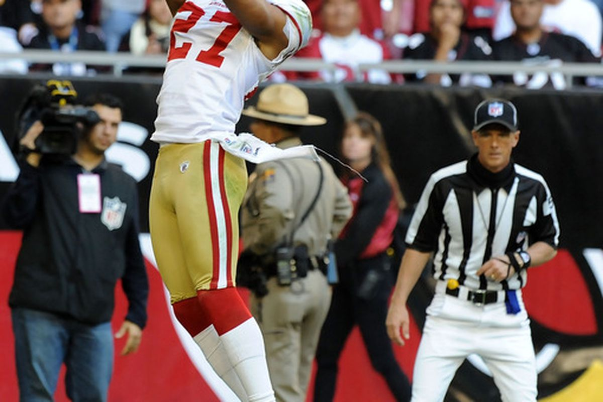 GLENDALE, AZ - DECEMBER 11:  C.J. Spillman #27 of the San Francisco 49ers downs a punt at the one yard line against the Arizona Cardinals at University of Phoenix Stadium on December 11, 2011 in Glendale, Arizona.  (Photo by Norm Hall/Getty Images)