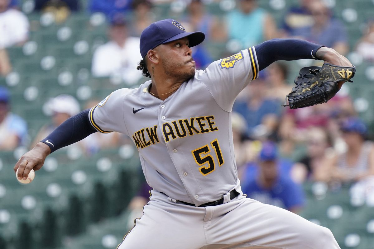 Freddy Peralta #51 of the Milwaukee Brewers throws a pitch against the Chicago Cubs at Wrigley Field on August 10, 2021 in Chicago, Illinois.