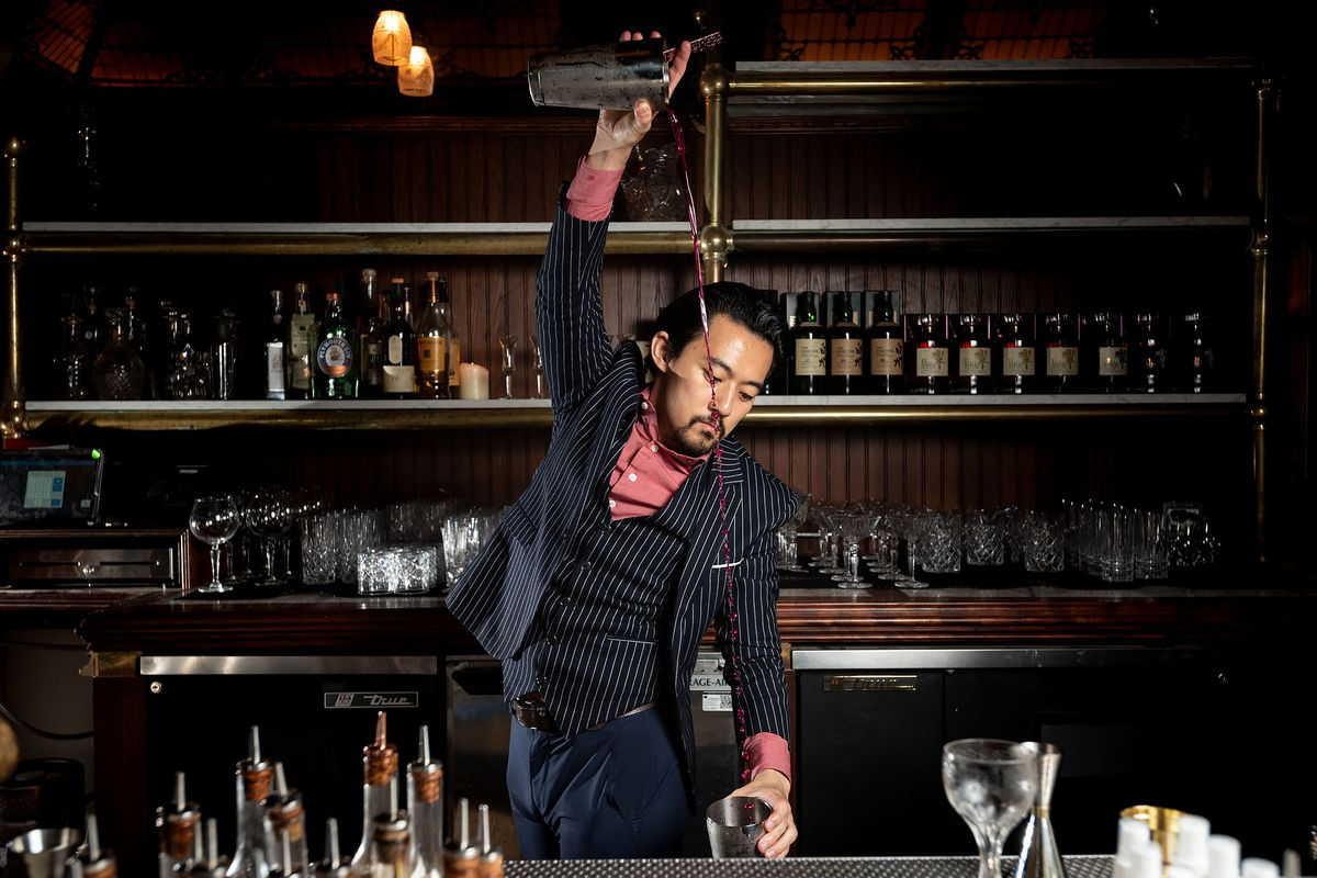 Kevin Lee bartender pouring a drink with flair at The Wolves in Downtown LA