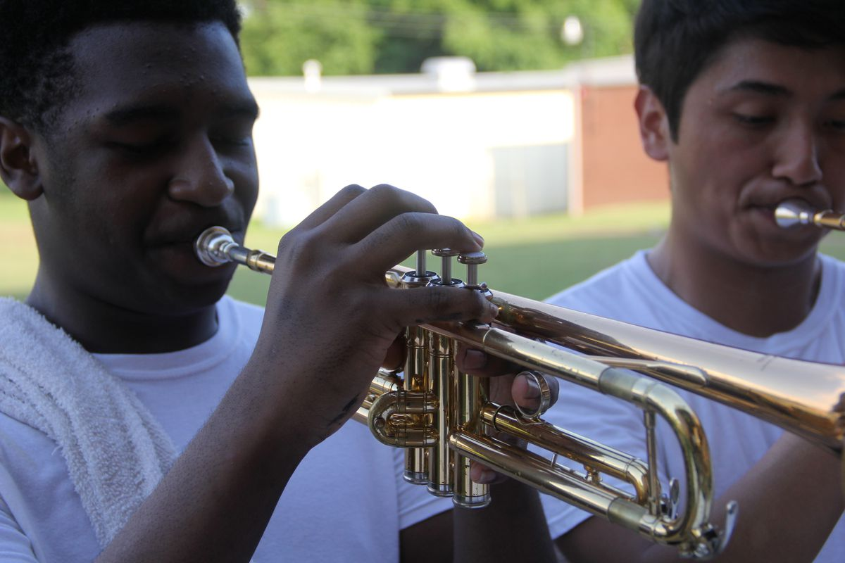 Trumpet players, including Jose Perez (right), during an afternoon practice session