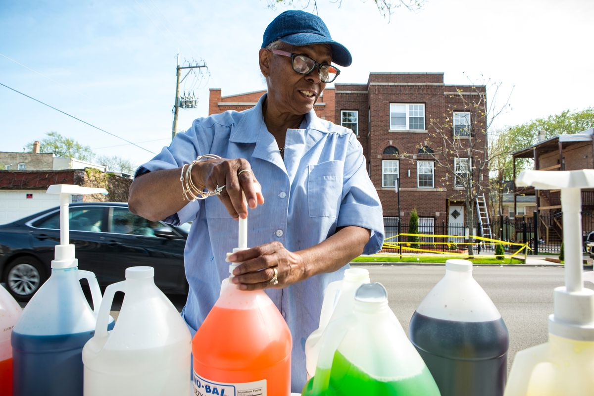 Jamie Roberts serves shaved ice in the area that's at the heart of Chicago's opioid epidemic. Her son died from a Fentanyl overdose, and she's trying to send a message that drugs and crime aren't welcome on her block. | James Foster / Sun-Times