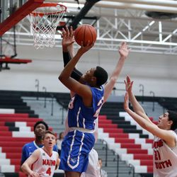 Crane's Robert Hobbs (23) Scores agaiinst Maine South in their 60-40 loss in Park Ridge, Saturday, February 9 2019.   Kevin Tanaka/For the Sun Times