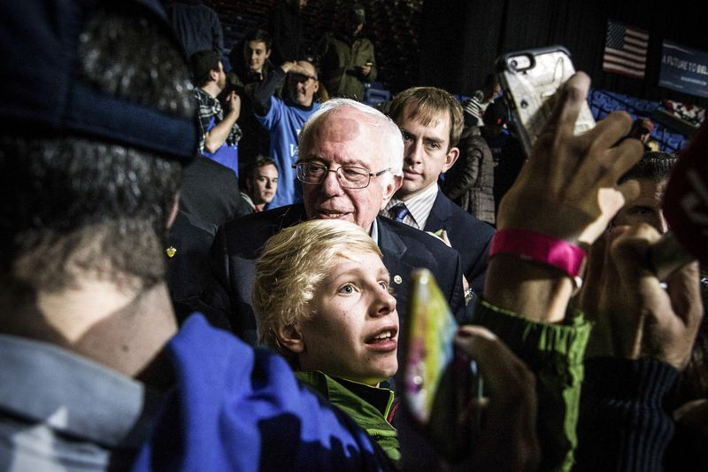 Democratic presidential hopeful, Sen. Bernie Sanders (D-VT) shakes hands with audience members after speaking at a campaign rally at the University of New Hampshire on February 8, 2016 in Durham, New Hampshire.