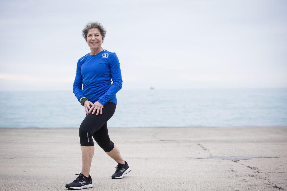 Gayle McMurry trains for the Boston Marathon on the Lakeshore Path on Monday in Chicago. McMurry will run with other members of 261 Fearless, a global network for women around the world to connect, support and inspire one another through running. The grou