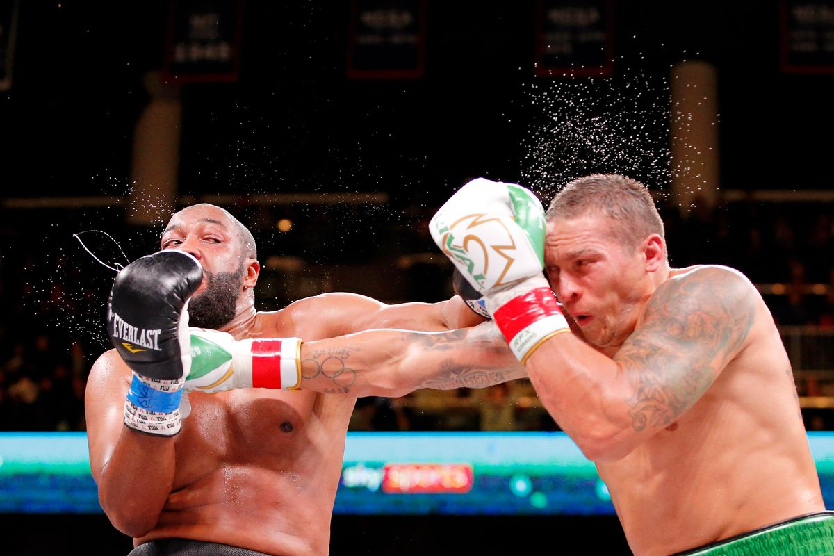 Oleksandr Usyk (white trunks) and Chazz Witherspoon (gray trunks) box during a heavyweight boxing match at Wintrust Arena