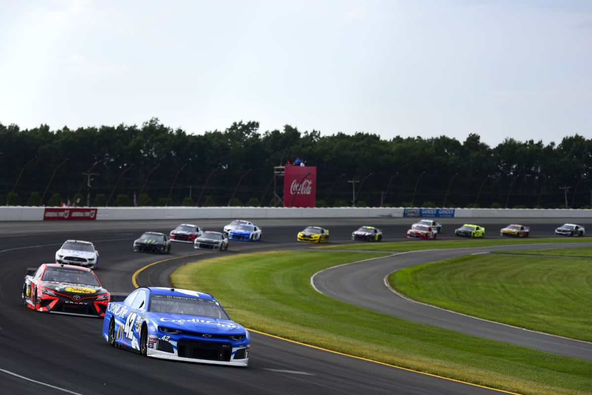 Kyle Larson, driver of the #42 Credit One Bank Chevrolet, leads a pack of cars during the Monster Energy NASCAR Cup Series Gander RV 400 at Pocono Raceway on July 28, 2019 in Long Pond, Pennsylvania.