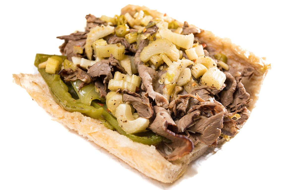 An Italian beef sandwich with hot and sweet peppers.