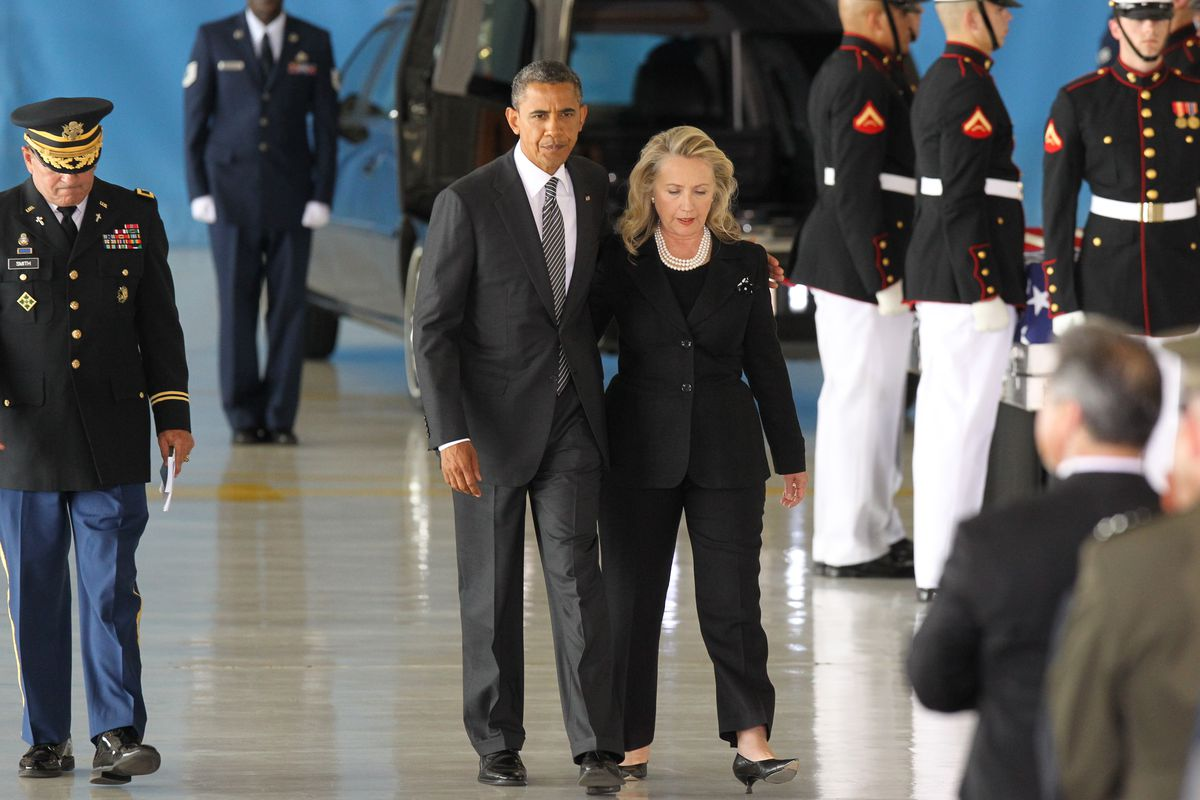 Obama and Clinton at a ceremony receiving the remains of Americans killed in the 2012 terrorist attack in Benghazi, Libya.