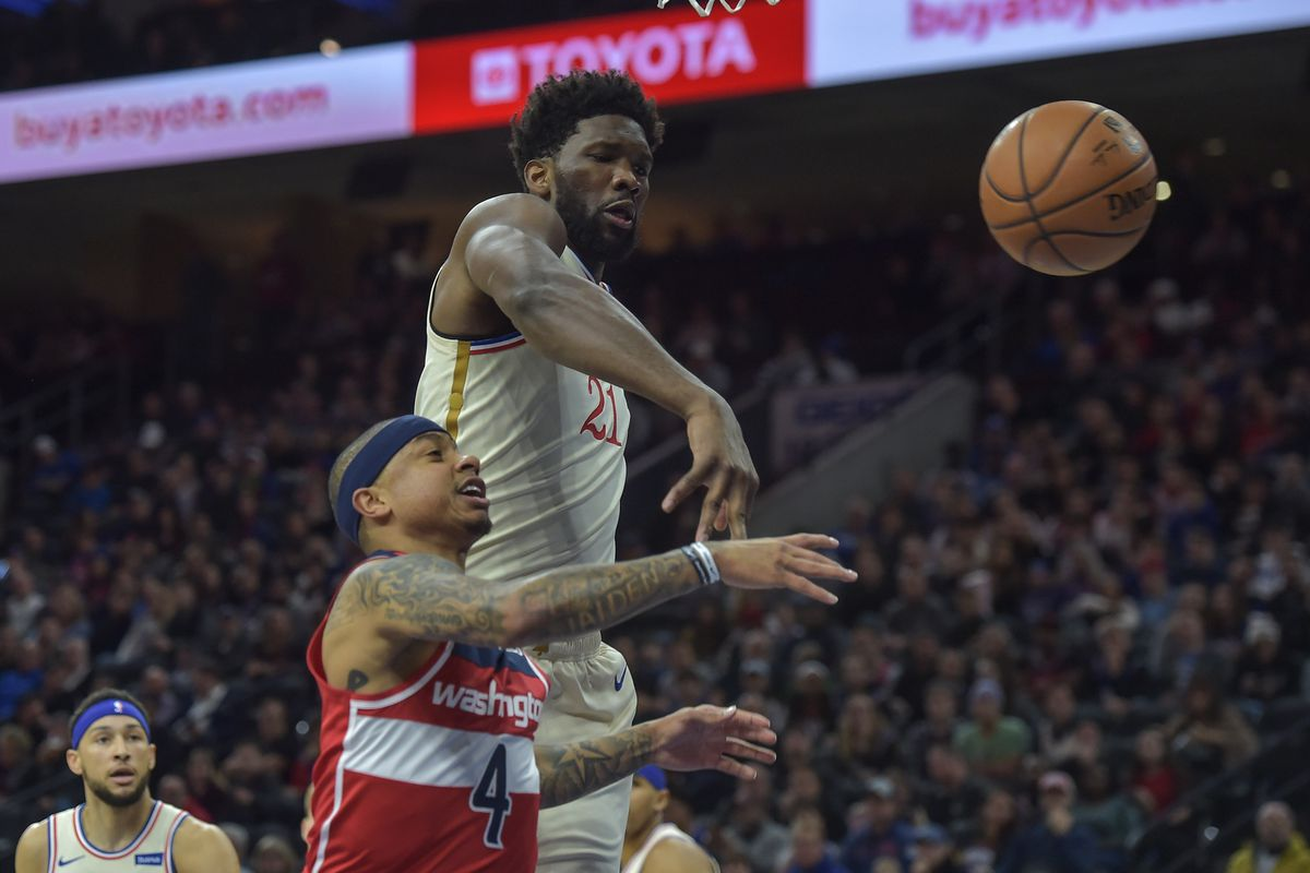 Philadelphia 76ers center Joel Embiid blocks a shot by Washington Wizards guard Isaiah Thomas during the first quarter of the game at the Wells Fargo Center.