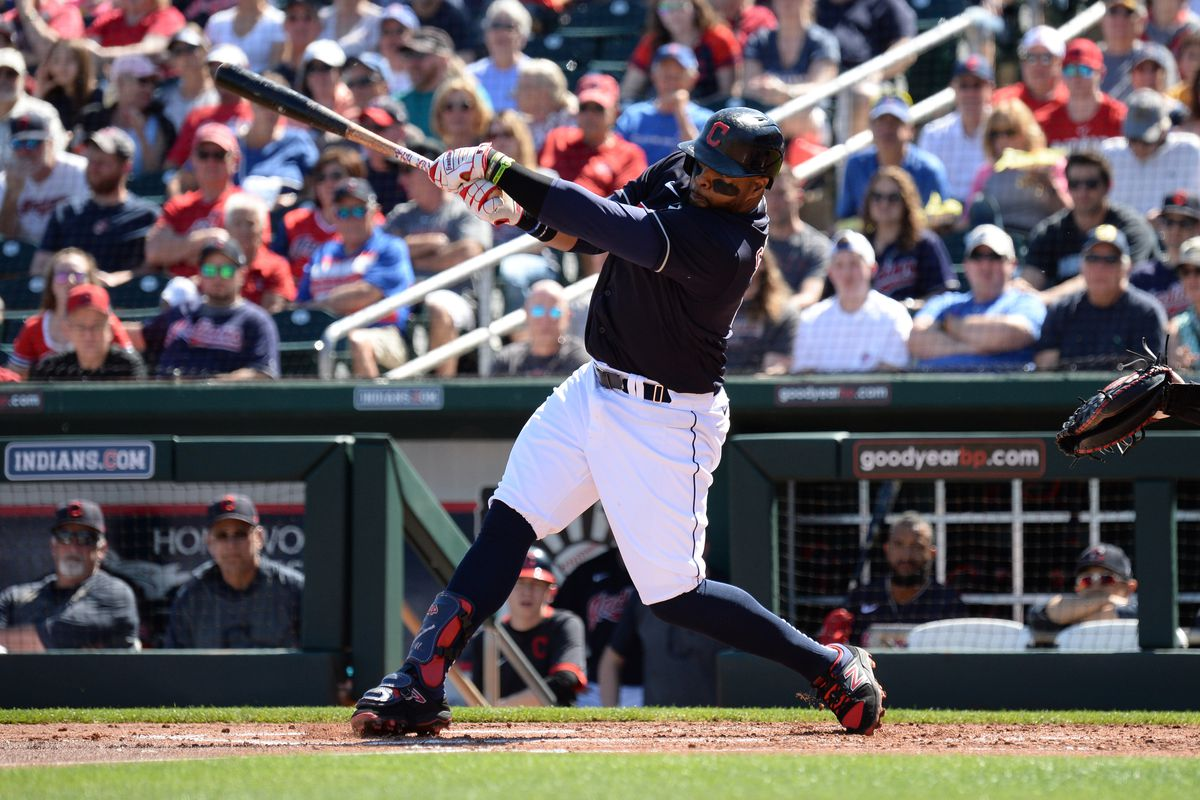 Cleveland Indians first baseman Carlos Santana bats against the Chicago Cubs during the first inning of a spring training game at Goodyear Ballpark.