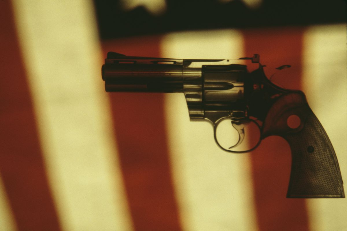 A gun in front of the American flag.