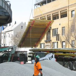 Concrere form being lifted into the left-field bleachers -