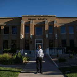 """Zacharia Levine, community development director for Grand County, poses for a photo outside the county offices in Moab on Friday, Sept. 9, 2016.  Approximately 95 percent of all real estate listings for homes in the Moab area are out of reach for moderate income families, a community dynamic that Levine says threatens the future of the region if leaders don't act to prioritize affordable housing.  """"Housing is economic development if you think about it. You cannot continue to grow your economy without providing housing for your workforce."""""""