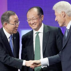United Nations Secretary-General Ban Ki-Moon, left, shakes hands with former U.S. President Bill Clinton after they participated in a panel discussion with World Bank President Jim Yong Kim, center, at the Clinton Global Initiative in New York on Sunday, Sept. 23, 2012.
