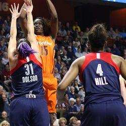 Connecticut Sun's Anieka Henry-Morello (15) puts up a short jumper over Washington Mystics' Stefanie Dolson (31).