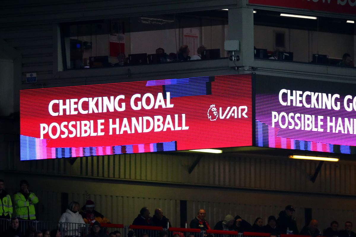 A screen inside the stadium explains to fans that a VAR check is in process before the awarding of Liverpool's first goal - Liverpool FC v Wolverhampton Wanderers - Premier League