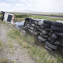 A recreational vehicle and a semitrailer lay on their sides after being toppled by the wind on I-80 near Dugway on Monday, June 12, 2017.