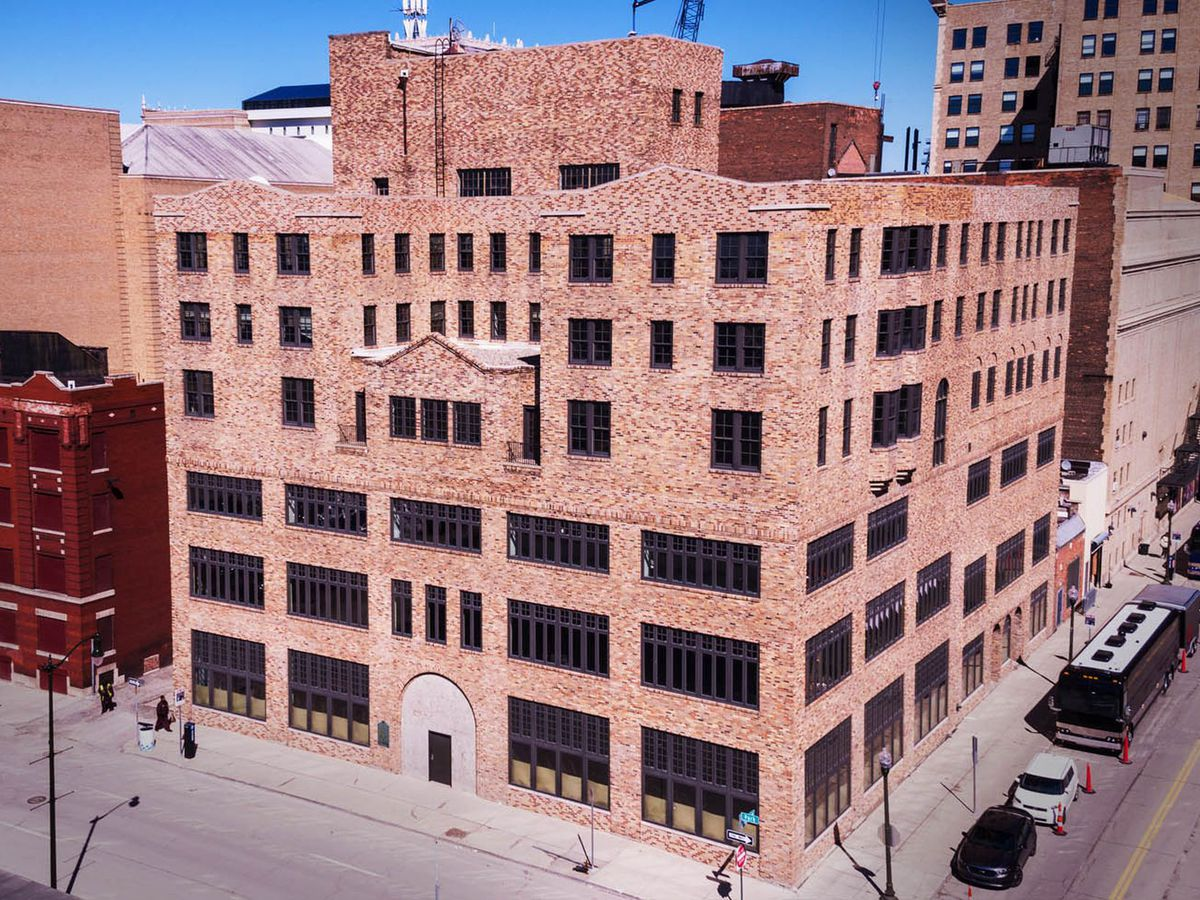The exterior of the Women's City Club building in Detroit. The facade is red brick with multiple windows.