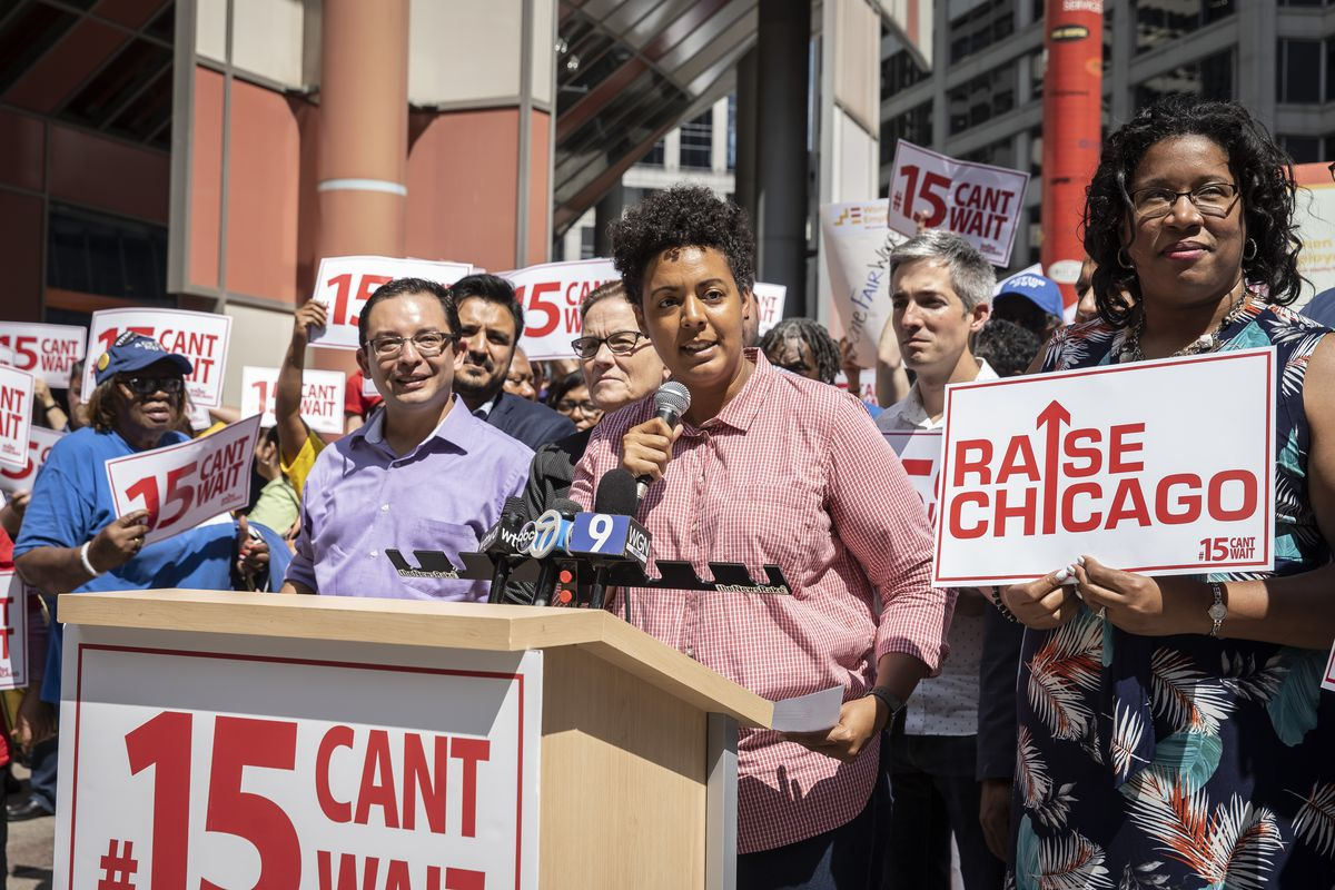 49th Ward alderman Maria Hadden, with microphone, was among those attending a rally in August pushing for an increase in the city's minimum wage.