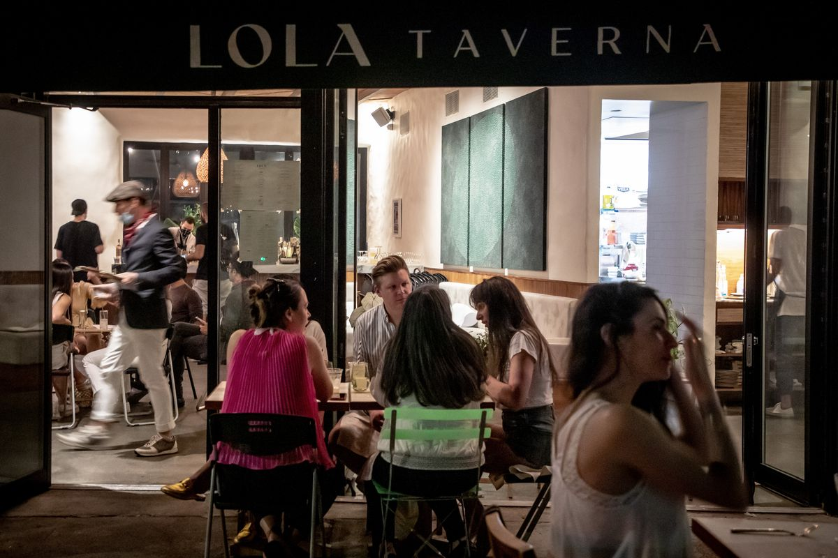 Indoor and outdoor dining at Lola Taverna