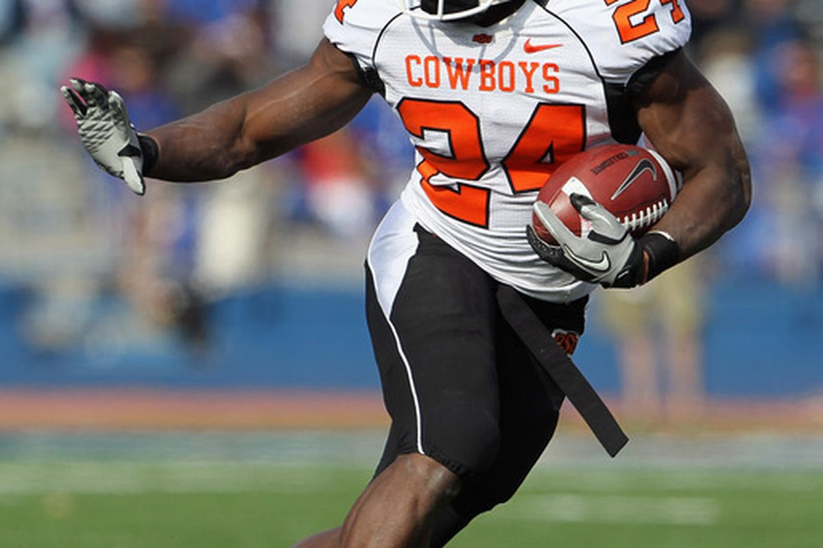 LAWRENCE KS - NOVEMBER 20:  Running back Kendall Hunter #24 of the Oklahoma State Cowboys carries the ball during the game against the Kansas Jayhawks on November 20 2010 at Memorial Stadium in Lawrence Kansas.  (Photo by Jamie Squire/Getty Images)