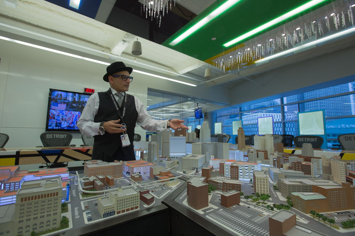 Dan Gilbert's full-time tour guide, Bruce Schwartz, shows off a model of downtown Detroit with Gilbert-controlled buildings lit up.