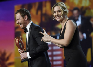 """Michael Fassbender with his """"Steve Jobs"""" co-star and award presenter Kate Winslet.   Chris Pizzello/Invision/AP Photo"""