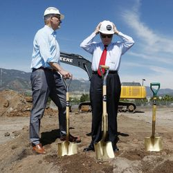 Colorado Springs, Colo., Mayor John Suthers, right, adjusts his helmet as Dick Celeste, chairman of the board of the U.S. Olympic Museum, looks on during a ceremonial groundbreaking for a new Olympic museum Friday, June 9, 2017, in Colorado Springs, Colo. The $75-million project will be built just blocks away from the U.S. Olympic Committee headquarters an the U.S. Olympic Training Center and breathe new life into the city's core.
