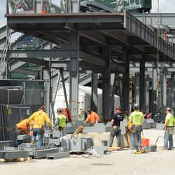 2:18 p.m. Assembling the framework for the right-field video board -