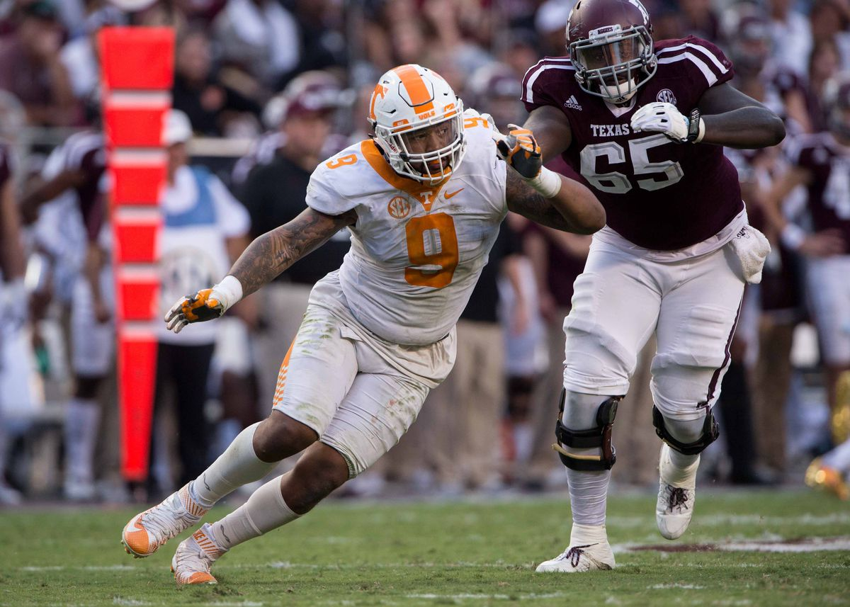 COLLEGE STATION, TX - Tennessee Volunters defensive end Derek Barnett (9) bends the edge around Texas A&M Aggies left tackle Avery Gennesy (65) at Kyle Field.