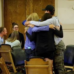 A group stands and hugs after listening to Thomas McConkie of Lower Lights following mediation and discussion in Salt Lake City on Wednesday, June 14, 2017.