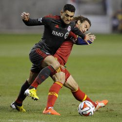 Real Salt Lake midfielder Kyle Beckerman (5) collides with Toronto FC forward Gilberto Oliveira Souza Junior (9) during a game at Rio Tinto Stadium in Sandy on Saturday, March 29, 2014.