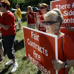 """Nancy Shaw, a teacher from Ogden City School District who has been teaching 43 years, protests with hundreds of other supporters during a rally in Ogden Thursday, July 14, 2011, against the """"take it or leave it"""" contract issued to Ogden teachers several weeks ago."""
