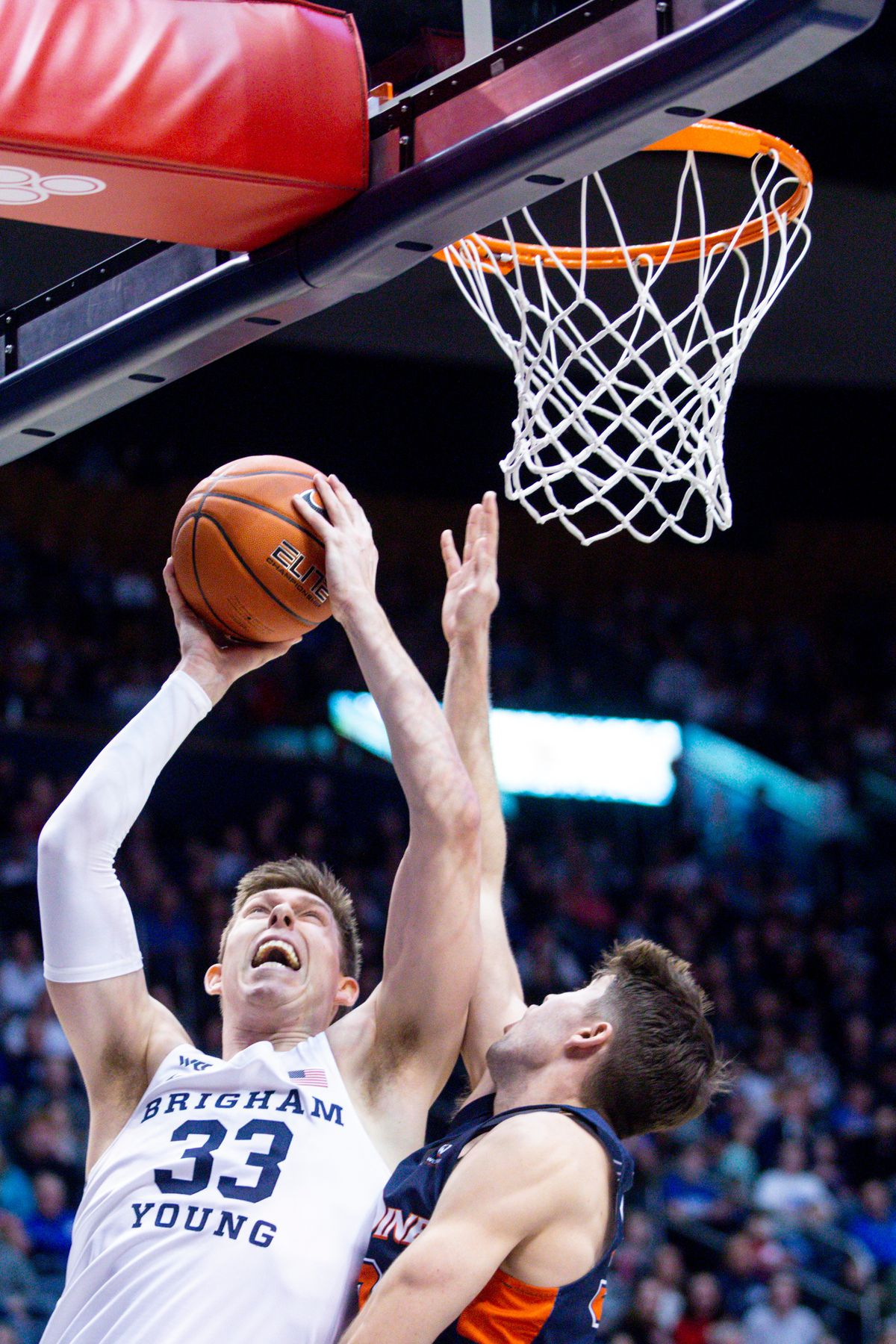 Brigham Young Cougars forward Dalton Nixon (33) jumps to the basket while Pepperdine Waves guard Skylar Chavez (33) attempts to block him in Provo on Thursday, Jan. 30, 2020. BYU won 107-80.