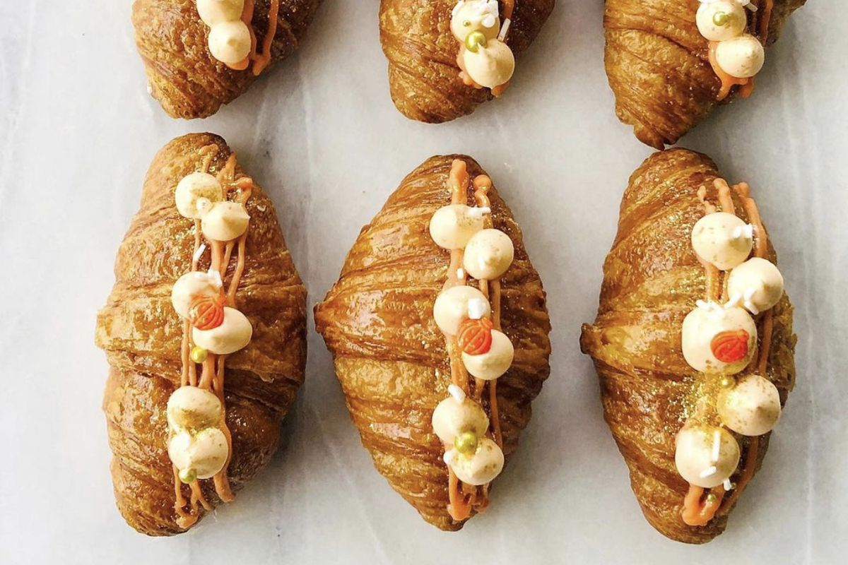 Six croissants with cream puffs on top