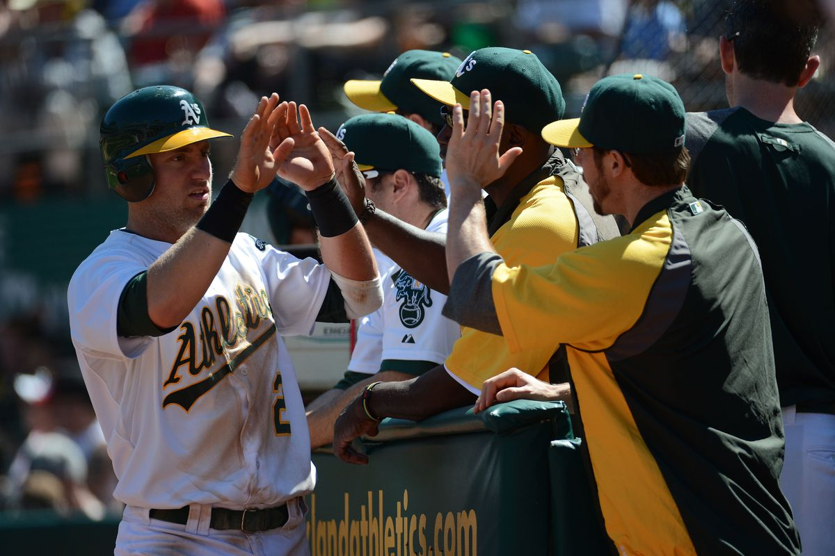 September 2, 2012; Oakland, CA, USA; Oakland Athletics second baseman Cliff Pennington (2) is congratulated for scoring during the fourth inning against the Boston Red Sox at O.co Coliseum. Mandatory Credit: Kyle Terada-US PRESSWIRE