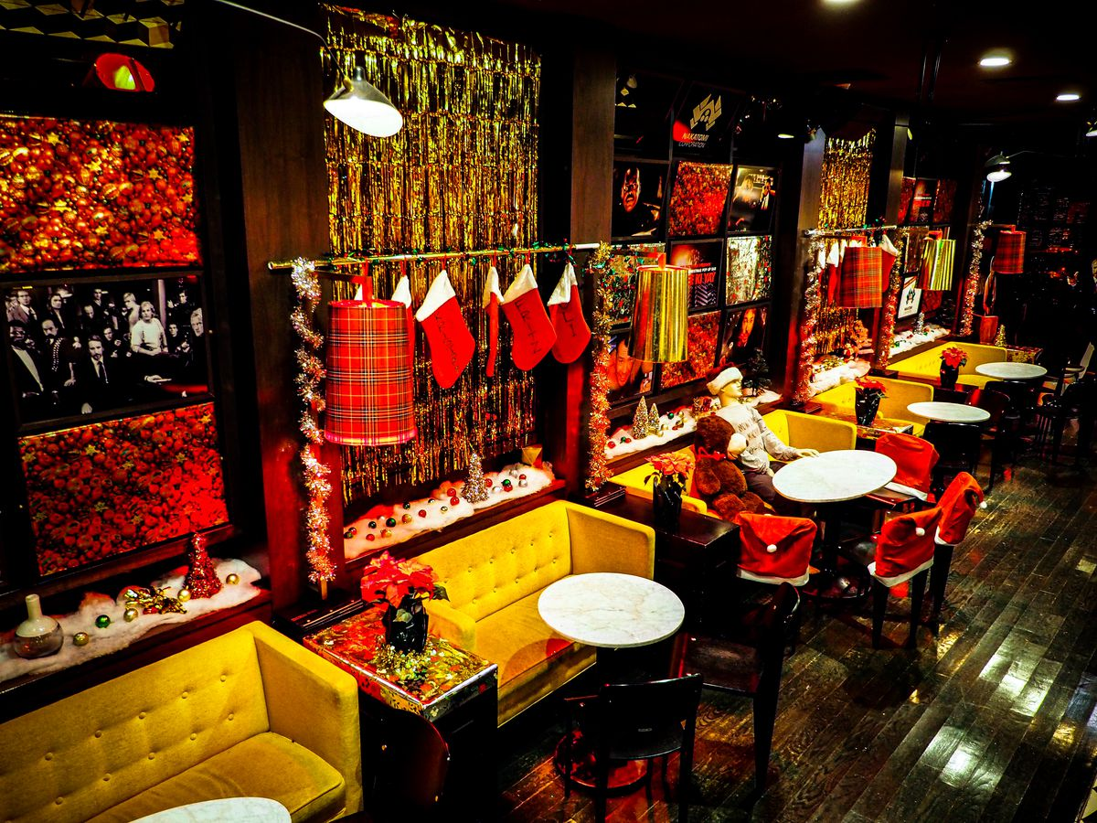 A cocktail bar with lots of Christmas decorations.