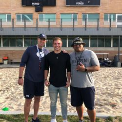 Josh Wilson, center, poses for a photo with BYU head coach Kalani Sitake, right, and Ed Lamb, BYU assistant head coach/special teams coordinator and linebackers coach.