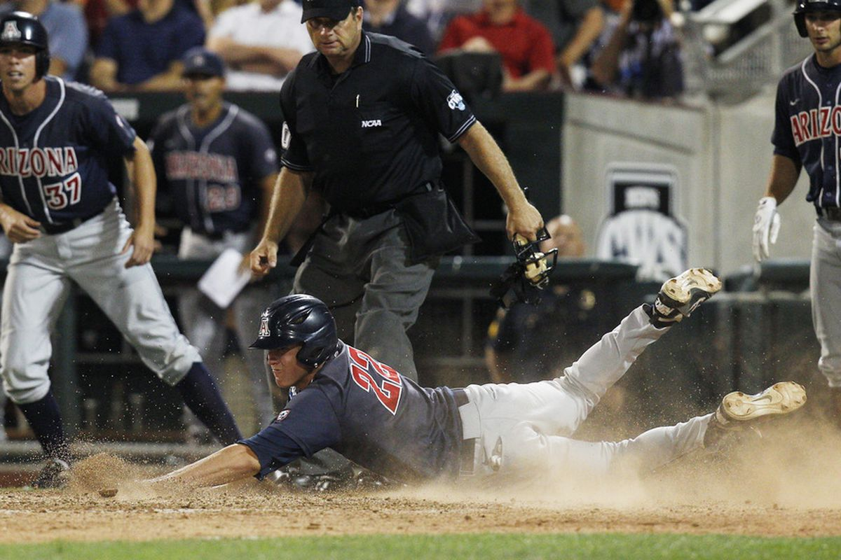 Brandon Dixon scored the game-tying run after a huge comeback from the Arizona Wildcats.  Arizona went on to defeat Arizona State 10-9