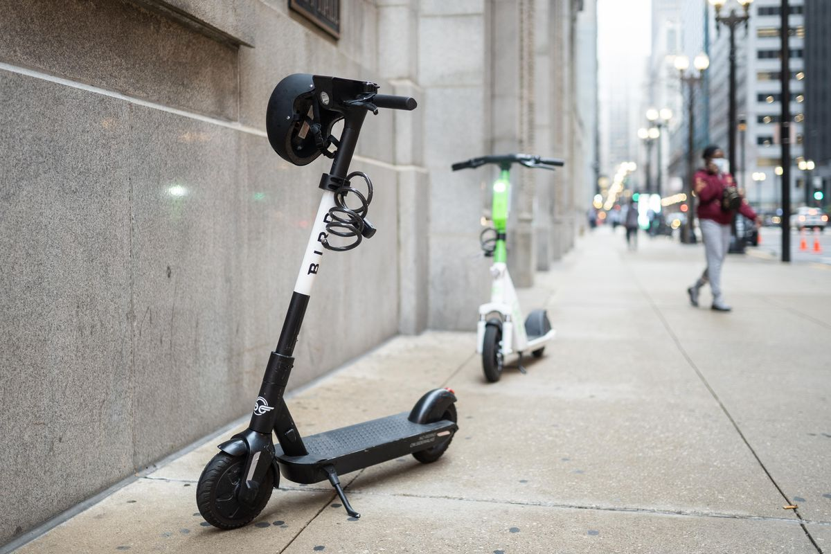 Electric scooters from Bird and Lime were part of a news conference outside City Hall on Monday, where Ald. Howard Brookins Jr. urged his fellow City Council members to approve a permanent e-scooter rental program.